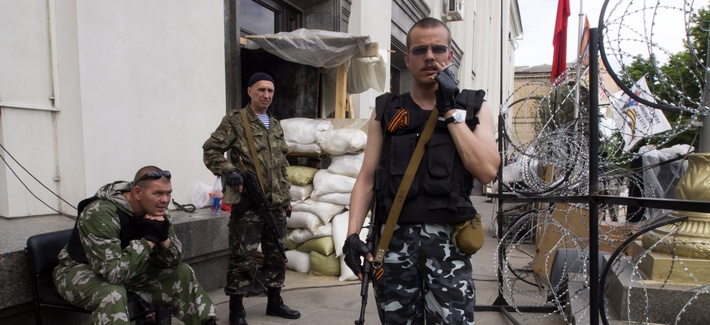 Pro-Russian insurgents stand guard in Luhansk, Ukraine, on May 25, 2014.
