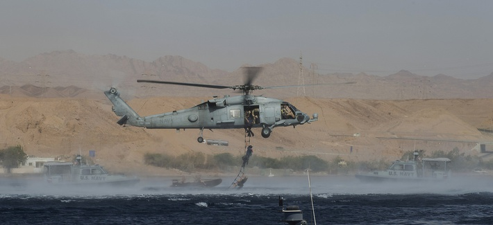 Explosive Ordnance Technicians assigned to CTG 56.1 conduct mine countermeasure exercises during Exercise Eager Lion 2014 in the Gulf of Aqaba, Jordan, on May 28, 2014.