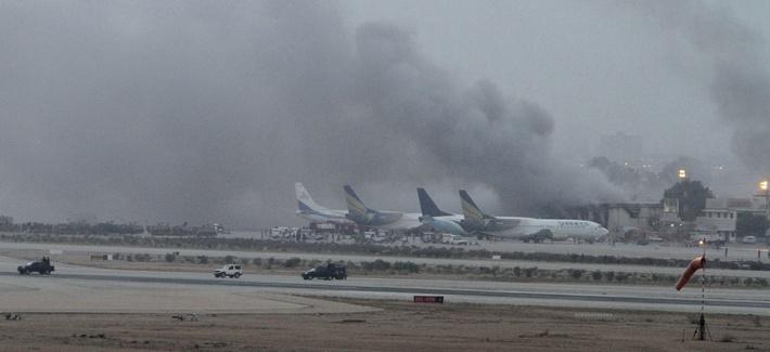 Smoke rises as security forces battle militants at Jinnah International Airport in Karachi, Pakistan, on June 9, 2014.