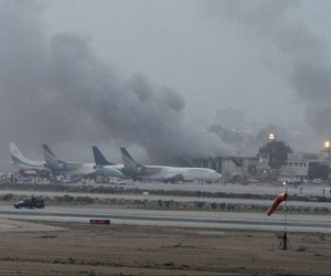 Smoke rises as security forces battle militants at Jinnah International Airport in Karachi, Pakistan, on June 9, 2014.