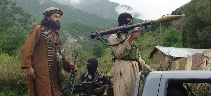 Pakistani Taliban patrol in the tribal region of South Waziristan on August 5, 2012.