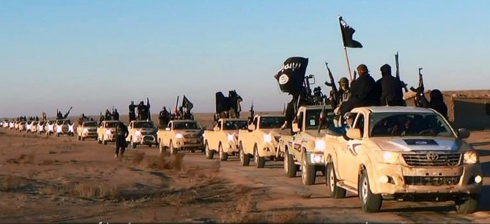 A convoy of vehicles carrying ISIS fighters travels to Iraq's Anbar province, on January 7, 2014.