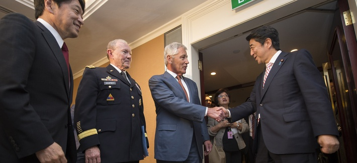 Defense Secretary Chuck Hagel and Joint Chiefs Chairman Gen. Martin Dempsey meet with Japanese Prime Minister Shinzo Abe at the Shangri La Hotel in Singapore, on May 30, 2014.