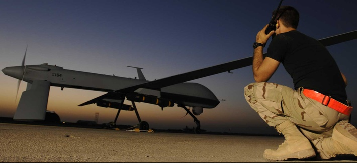 An airman at Ali Air Base in Iraq communicates with the pilot of an MQ-1 Predator drone, on November 5, 2007.