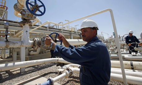 An employee works at the Tawke oil field in the Kurdish region in northern Iraq, on May 31, 2009.