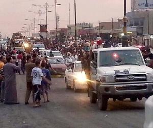Al Qaeda inspired militants parade down the street of Mosul, Iraq, on June 11, 2014.