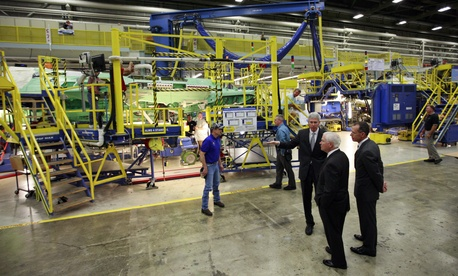 Former Defense Secretary Bob Gates inspects a F-35 Lightning II assembly line during a visit to a Lockheed Martin plant, on August 31, 2009.