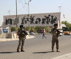 Two Iraqi soldiers stand guard in Baghdad's Tahrir square on June 16, 2014.