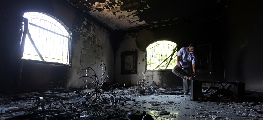 A Libyan man investigates the inside of the U.S. Consulate in Benghazi, Libya, on September 13, 2012.