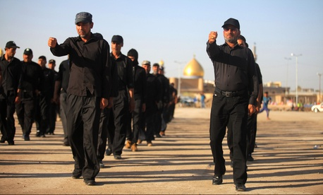 Volunteers train at a military base in the Shiite holy city of Najaf, Iraq, on June 17, 2014.