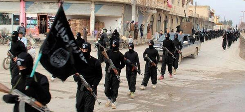 This undated file image posted on a militant website on Tuesday, Jan. 14, 2014 shows fighters from the al-Qaida linked Islamic State of Iraq and the Levant (ISIL) marching in Raqqa, Syria. The ISIL led by Abu Bakr al-Baghdadi, who is believed to have been
