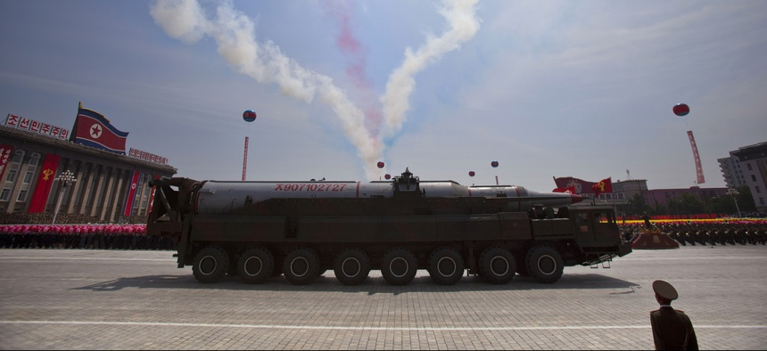 A North Korean missile rolls through Kim Il Sung Square in Pyongyang during a military parade on July 27, 2013.