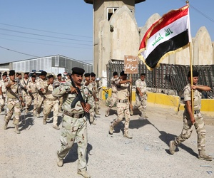 Members of the Iraqi Army march inside a recruiting center in Baghdad, Iraq, on June 19, 2014.
