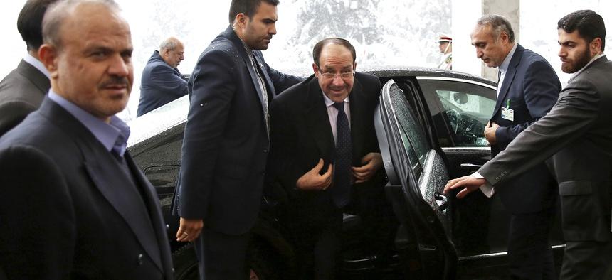 Iraqi PM Nouri al-Maliki arrives in Tehran for a meeting with former Iranian president Rafsanjani, on December 5, 2013.