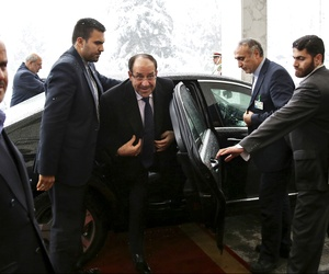 Iraqi PM Nouri al-Maliki arrives in Tehran for a meeting with former Iranian president Rafsanjani, on December 5, 2013.
