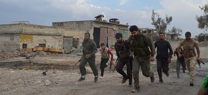 Free Syrian Fighters run at the front lines in the town of Sheikh Najjar, in Aleppo, Syria, on June 10, 2014.