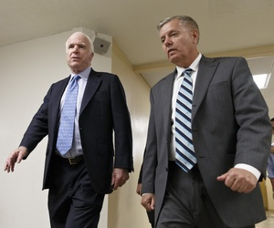 Sens. John McCain, R-Ariz., and Lindsey Graham, R-S.C., leave the Senate after a series of votes, on June 3, 2014.