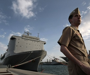 A sailor in Rota, Spain stands besides the MV Cape Ray, the American ship that will be used to neutralize Syria's chemical weapons stockpile, on April 10, 2014.