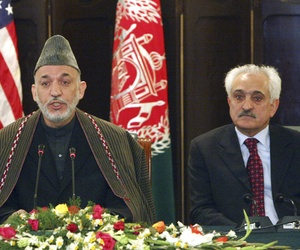 Afghan president Hamid Karzai and Rangin Dadfar Spanta listen during a press event at the presidential palace in Kabul, Afghanistan, on February 15, 2009.