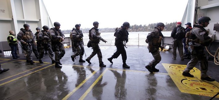 SWAT team members undertake training exercises on a Washington State ferry near, on October 29, 2012.