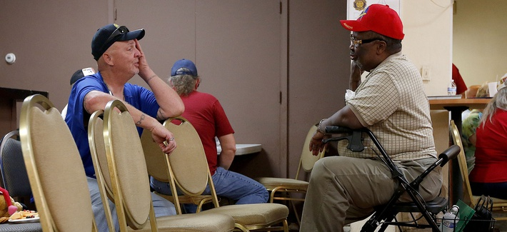 Two Army veterans talk as they wait at a health care crisis center set up by the American Legion in Phoenix, Arizona, on June 10, 2014.