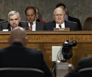 Sens. Jack Reed, D-R.I., Carl Levin, D-Mich., and James Inhofe, R-Okla., listen during a Armed Services Committee hearing, on April 3, 2014.