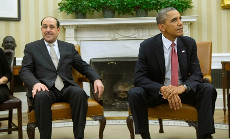 President Barack Obama and Iraqi Prime Minister Nouri al-Maliki stay in their seats, Nov. 1, 2013, following a meeting in the Oval Office of the White House in Washington.