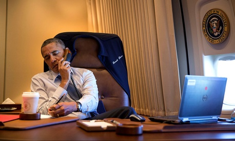 President Obama works at his desk while traveling on Air Force One, on April 10, 2014.