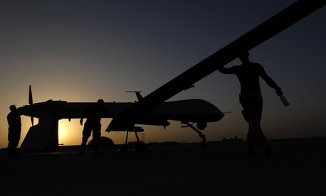 U.S. airmen conduct a pre-flight inspection on an MQ-1 Predator Unmanned Aerial Vehicle Nov. 5, 2007, at Ali Base, Iraq.
