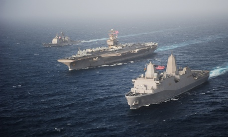 The USS New York (right) sails with the USS Abraham Lincoln and USS Cape St. George through the Arabian Sea, on June 9, 2012.