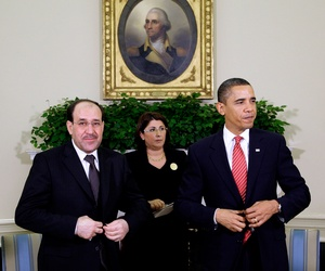 President Barack Obama and Iraqi Prime Minister Nouri al-Maliki, left, stand after their meeting in the Oval Office at the White House in Washington, Oct. 20, 2009.