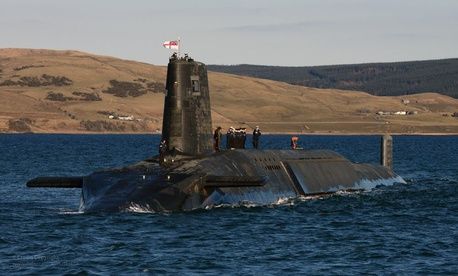 The HMS Victorious, one of the United Kingdom's Trident Class submarines, emerges from Devonshire Dock Hall in Barrow.