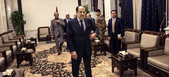 Iraqi Prime Minister Nouri al-Maliki waits for Secretary of State John Kerry ahead of a meeting on June 23, 2014.