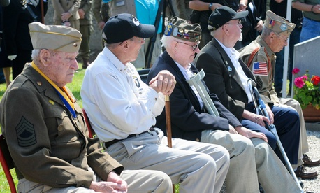 Military retirees listen to a presentation at Fort Bliss, Texas, on June 2, 2012.