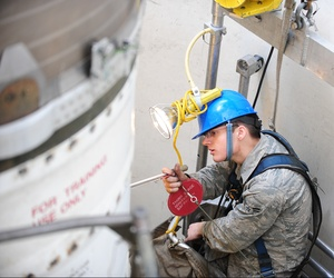 An airman at Minot Air Force Base inspects one of the components on a Minuteman III missile, on April 11, 2013.