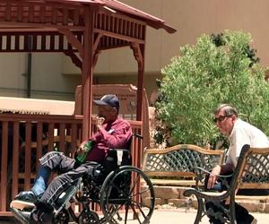 Men sit outside the Raymond G. Murphy VA Medical Center in Albuquerque, N.M., Thursday, July 3, 2014.