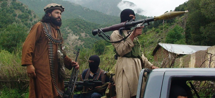 Pakistani Taliban patrol in the tribal region of South Waziristan on August 5, 2012.