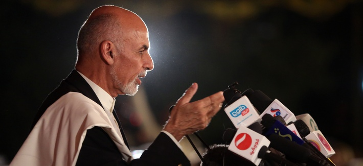 Afghanistan's leading presidential candidate Ashraf Ghani Ahmadzai speaks for his allies, in front of the media representatives, at his resident in Kabul, Afghanistan, June 25, 2014.