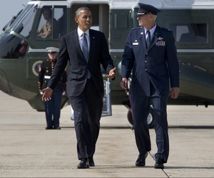 President Obama is greeted as he arrives at Andrews Air Force Base, Md., on July 8, 2014.