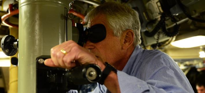 Defense Secretary Chuck Hagel tries the periscope aboard the Ohio-class nuclear submarine USS Tennessee at Submarine Base Kings Bay, Ga. Jul. 9, 2014.
