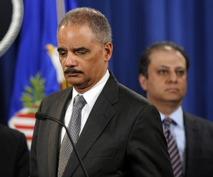 Attorney General Eric Holder speaks about a deal between the U.S. government and French bank BNP Paribas, on June 30, 2014.