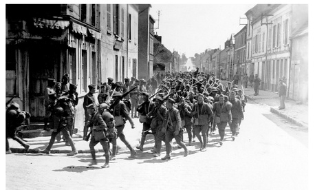 Soldiers with the 30th Infantry, 3rd Division, march through Viele Maisons, France, on June 2, 1918.