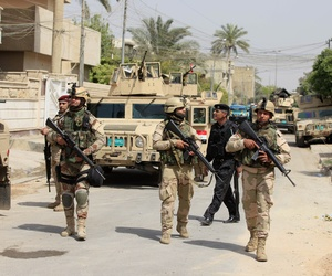 Iraqi Army soldiers patrol in Baghdad's Adhamiya district, on April 18, 2013.