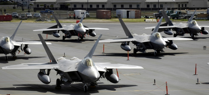 F-22 Raptors with the 27th Fighter Squadron sit on the flightline at Hickam Air Force Base, Hawaii.