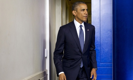 President Obama walks out to the James Brady Press Briefing Room to discuss foreign policy with reports, on July 16, 2014.