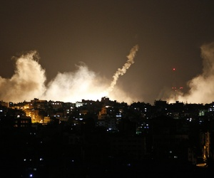 Smoke rises over Gaza City, in the northern Gaza Strip, where Israeli forces began a ground invasion following 10 days of rocket fire, on Thursday, July 17, 2014.