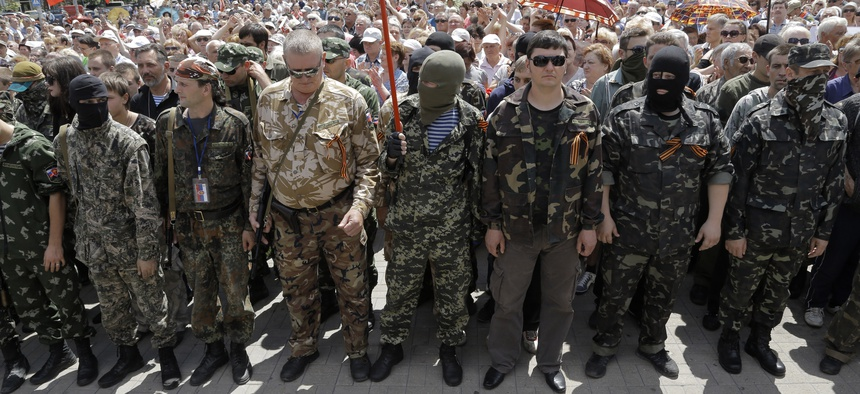 Pro-Russian fighters in the city of Donetsk gather to take an oath of allegiance to the self-proclaimed Donetsk People, on June 22, 2014.