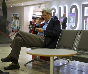 Secretary of State John Kerry speaks on his cell phone at Shannon Airport in Ireland on March 29, 2014.