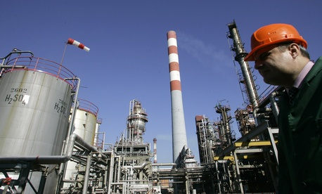 A worker at the NIS Jugopetrol oil refinery prior to a visit by Russian prime minister Dmitry Medvedev.