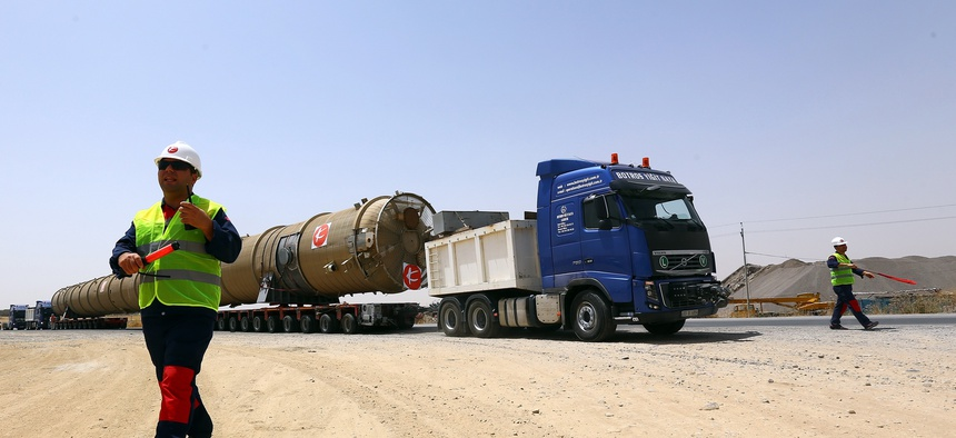 New oil refinery equipment arrives at Kalak refinery on the outskirts of Irbil, Iraq, on July 14, 2014.
